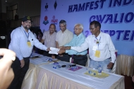 Technical Class license being handed over to OM Ariff VU3ARF by Hamfest India 2013 Organizers.